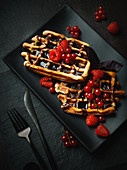 Waffles with chocolate sauce and fresh berries