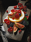 A dessert tartlet with honey, summer berries and figs