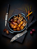 Roast potatoes with red onions and shimeji mushrooms