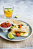 Quesadillas with potato and spinach filling and tomato salsa