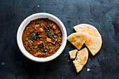 Kale and lentil soup with pita