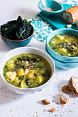 Kale, cauliflower and pototoe soup garnished with sesame seed