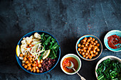 Vegan bowl with roasted spicy chickpeas, kale, wild rice and roasted cauliflower