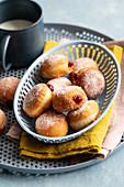 Mini doughnuts with raspberry jam