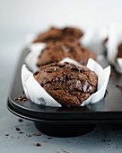 Chocolate muffins in white muffin cases