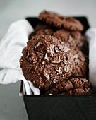 Vegan chocolate biscuits in a black loaf tin
