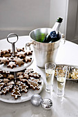 Christmas cookies on a cake stand and sparkling wine