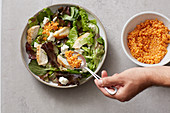 A basic salad with sheep's cheese and red lentils for energy