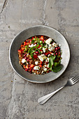 Freekeh salad with pomegranate seeds and feta cheese