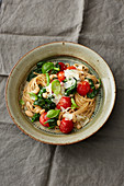 Wholemeal pasta with white beans, spinach and cherry tomatoes
