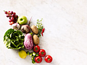 An arrangement of vegetables, lettuce, herbs and fruit