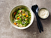 Couscous salad with pumpkin, rocket and pine nuts