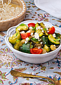 Grilled vegetable salad with feta in a white bowl