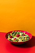 A summer couscous salad with raspberries and vegetables