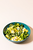 A fitness bowl with cucumber salad
