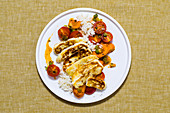 Fried halloumi with an oriental carrot medley and rice
