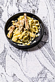 Tagliatelle with pork in a creamy wine and thyme sauce