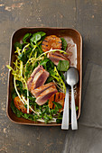 Tuna fish steaks with wild herbs and peaches