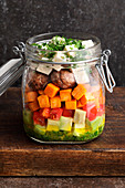 Baked sweet potato salad with meatballs