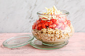 Strawberry and chocolate muesli in a jar