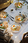 Waffles with fried quail eggs