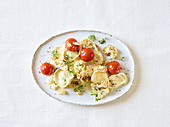 Roasted cauliflower with tomatoes and goat's cheese