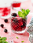 Blackberry bourbon smash with mint leaves and ice cubes