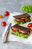 Vegan BLT sandwiches with tofu bacon