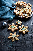 Snowflake shortbread biscuits with vanilla soy cream and blue powdered sugar (vegan)