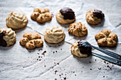 Vegan coconut biscuits, partly dipped with chocolate