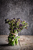 A bunch of purple sprouting brocoli
