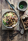 Bowl with delicious miso pasta with egg plants and Chinese mushrooms