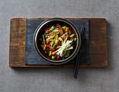 Vegan stir-fried tofu with mange tout