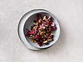 Radicchio salad with fried mushrooms and a nut topping