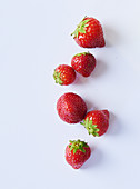Strawberries on a white surface