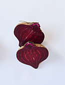 A halved beetroot on a white surface