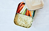 Vegetable crudités with bean hummus in a lunch box