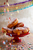 Doughnuts with rosehip jam decorated with confetti