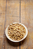 Pine nuts in a wooden bowl