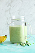 Vegan pea and banana shake with tofu and mint