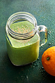 'Green Orange' with spinach, chia seeds and almonds