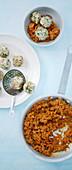 Mini dumplings with carrot bolognese
