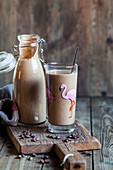 Vegan smoothies with almond milk, banana, coffee and flaxseed