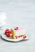 A slice of Neenish tart with raspberries