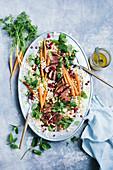 Lammtajine-Salat mit Orange, Karotte, Koriandergrün und Granatapfel