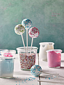 Cake pops with icing and colorful sugar sprinkles