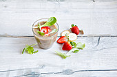 Strawberry smoothie with mixed leaves