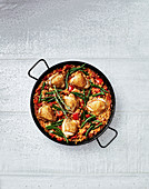 Paella Valenciana (Spain) with chicken and green beans