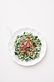 Spinach risotto with raw ham and hazelnuts
