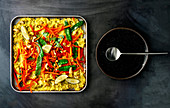 Coconut and curry rice with peppers and mange tout
